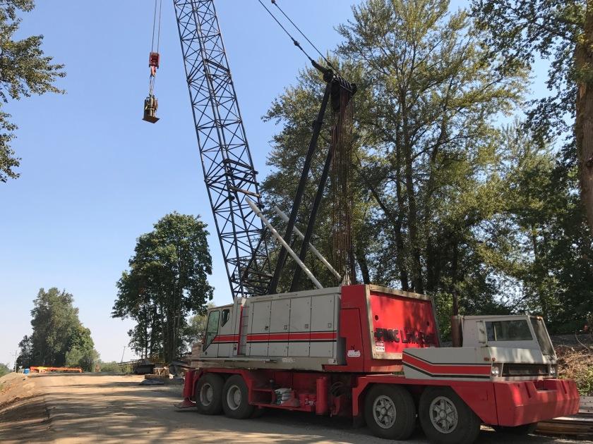 Massive crane past bridge