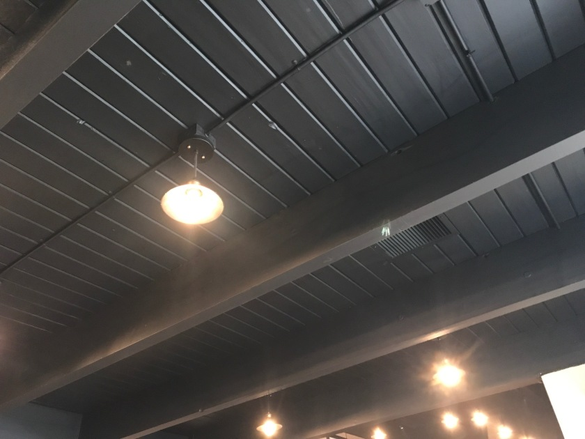 The black ceiling and Edison bulbs work very well together