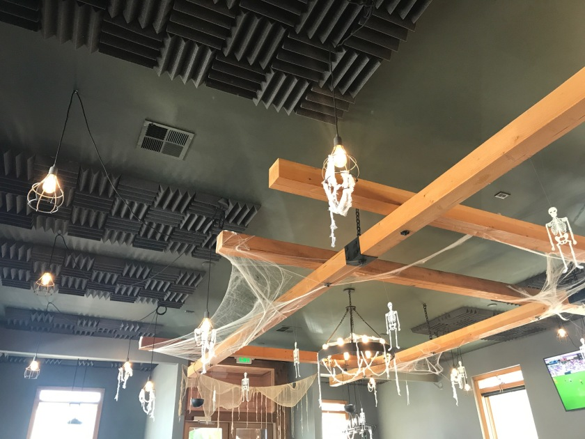 The ceiling has a suspended construct of beautiful wood and black steel on it