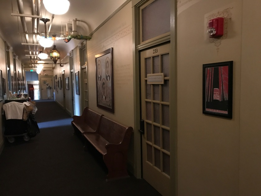 Another view of the second floor hallway with benched and artwork