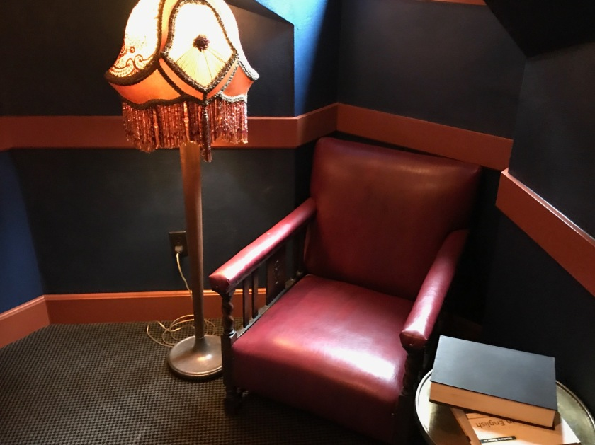 The reading nooks feature stuffed chairs, fancy tasseled floor lamps and a window to the outside.  They also frequently have reading suggestions just nearby