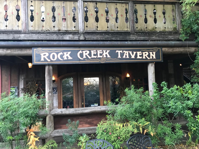The Rock Creek tavern main sign is easy to spot from the street - while most of the structure except the fireplace is wooden - adding to the vintage feel and esthetic