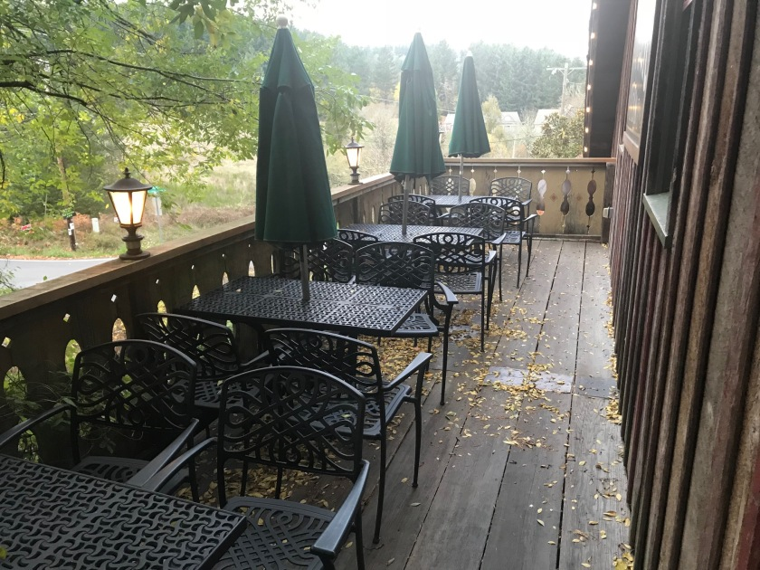 Tables on the second floor front porch