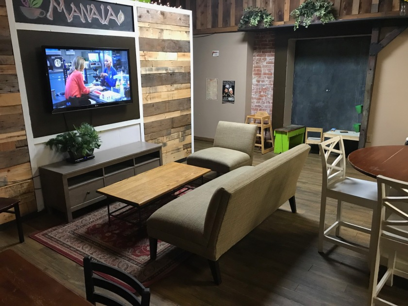 The television and couches are very comfortable and there is even a large chalkboard for kids