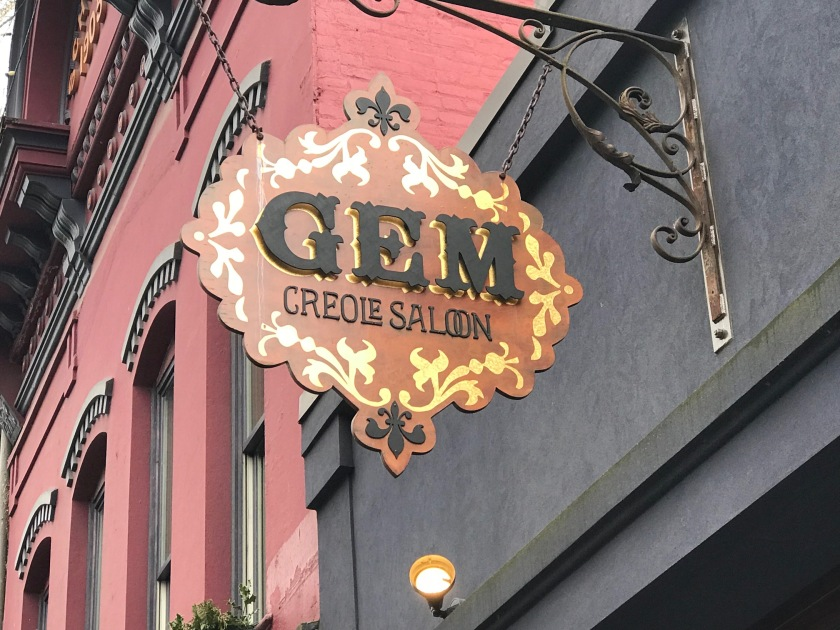 Gem's sign matches the rest of the exterior - with gold highlights and fleur-de-lis sigils
